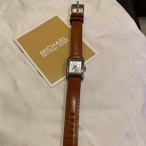 Michael Kors small leather watch.